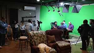 A video studio being used for a production.
